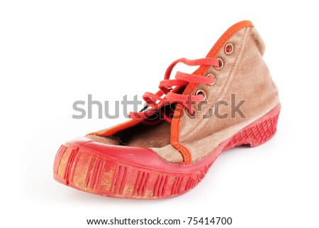 heavy used old red sport shoes, sneakers (isolated on white background, selective focus)