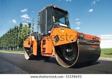 Heavy Vibration roller at asphalt pavement works (road repairing)