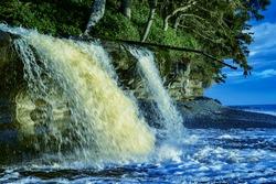 Heavy water flow in Sandcut beach waterfalls.