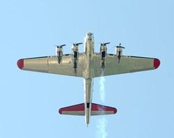 Heavy World War II era bomber flying overhead