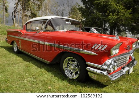 HEBY, SWEDEN - MAY 12: Exhibit of old American classic cars. Chevrolet Impala 58th and organizes are Restless cruisers and official name Restless cruisers in Heby, Sweden on May 12, 2012