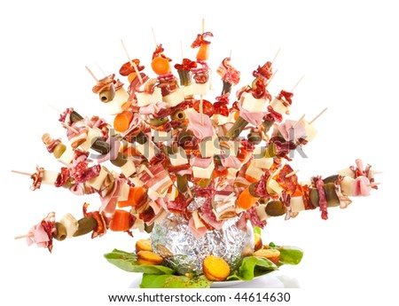hedgehog made from sticks with delicious food - isolated on white