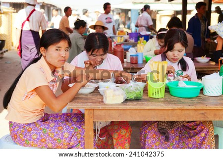 Heho, Myanmar - March 02, 2011 : Young Burmese women having lunch at five-day market. Five-day market is open once in every five days and is very busy
