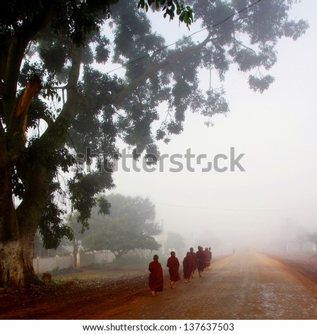 HEHO,MYANMAR - NOV. 28; Unidentified monks gathering offers on Nov.28, 2012 Myanmar.The first two monks carrying food on plates. This way of gathering offers is rarely seen anymore in Myanmar.