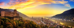 Heidelberg, Germany, aerial panoramic view at dusk, with colorful sunset sky, the castle, Neckar river and the Old Bridge