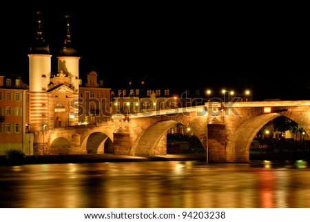 "Heidelberg, Germany, night shot of the illuminated historical ""Old Bridge"""