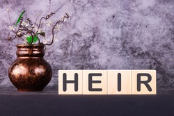 HEIR word made with building blocks on a black table
