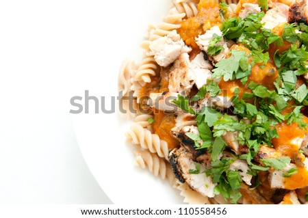 heirloom tomato sauce with diced chicken, cilantro, and fresh whole wheat rotini noodles