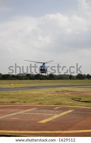 Helicopter and helipad