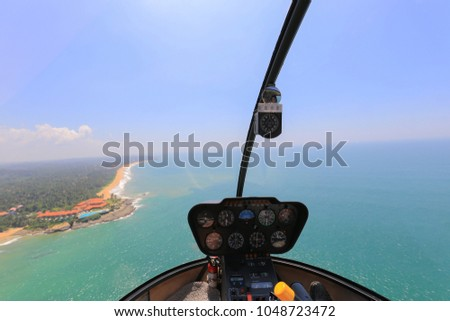 Helicopter cabin. Helicopter cockpit inside view. Robinson r44