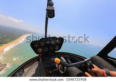 Helicopter cabin. Helicopter inside view. Robinson r44 #1048725908