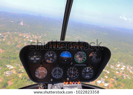 Helicopter cabin. Helicopter view inside the cabin. Robinson r44 #1022823358