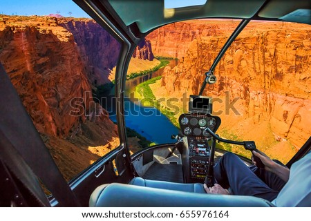 Helicopter cockpit with pilot arm and control console inside the cabin on the Grand Canyon Lake Powell. Reserve on the Colorado River, straddling the border between Utah and Arizona. USA, America.