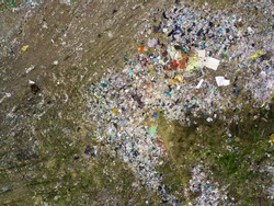 Helicopter drone shot. Aerial photography is a modern urban dump. Landfill with a lot of debris polluting the ecological environment of the city