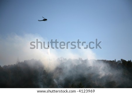 Helicopter Drops Water on Wildfire in southern Oregon on July 25, 2007