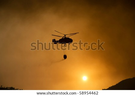 Helicopter fighting fire in Geres, north of Portugal