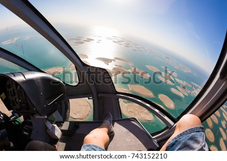 Helicopter flight over the sea. Dubai leisure. Eurocopter EC130. Luxury lifestyle.