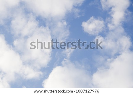Helicopter flying over a clouds height with blue sky background - Shutterstock ID 1007127976