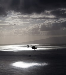 Helicopter hovers over Hawaii coast