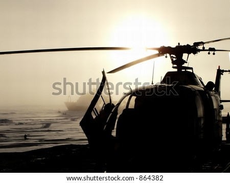 Helicopter in the Arctic sea
