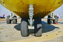 Helicopter landing gear with aircraft thrust pad. Landing gear of military helicopter. Wheel Of Airplane Or Helicopter.