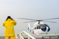 helicopter landing officer and alarm for the air rescue service. Team of rescuers medical helicopter.