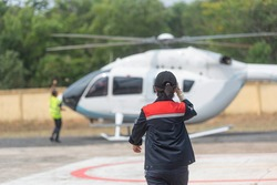 Helicopter Landing Officer(HLO) are training operations at the helipad.