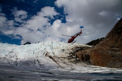 Helicopter landing on a glacier