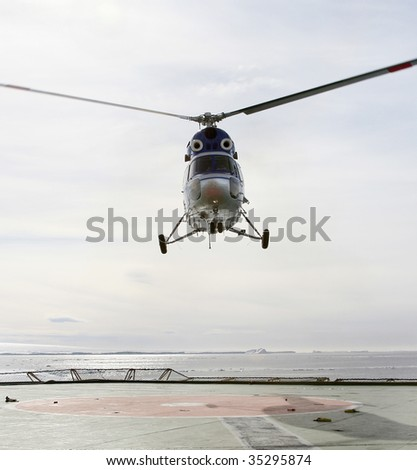 Helicopter landing on a Russian icebreaker in the Weddell Sea, Antarctica