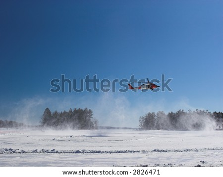 Helicopter landing on the snow