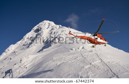 Helicopter mountain rescue service in the winter. Swinica in the High Tatras.