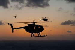 Helicopter over gorgeous Hawaii sunset horizon