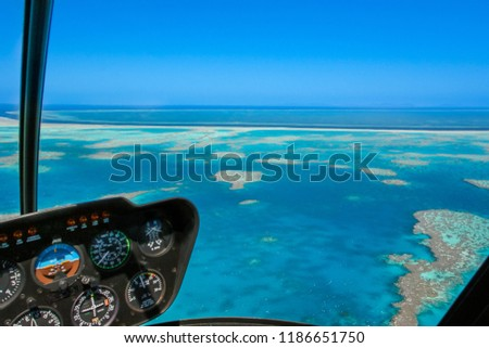 Helicopter over the Great Barrier Reef in Queensland, Australia. #1186651750