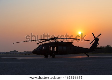 Helicopter parked at the helipad with sunset