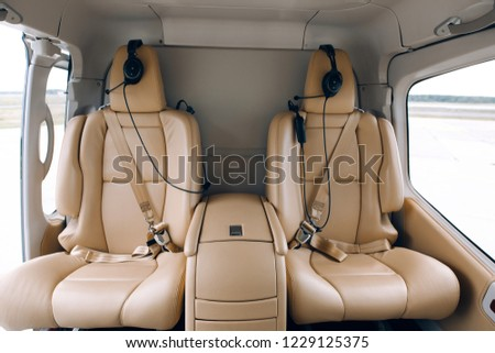 Helicopter passenger leather seats. Interior of luxury helicopter