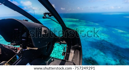 Helicopter ride over Moore Reef, part of the outer Great Barrier Reef in Australia #757249291