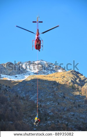 Helicopter search and rescue, carrying a climber to safety after a climbing accident