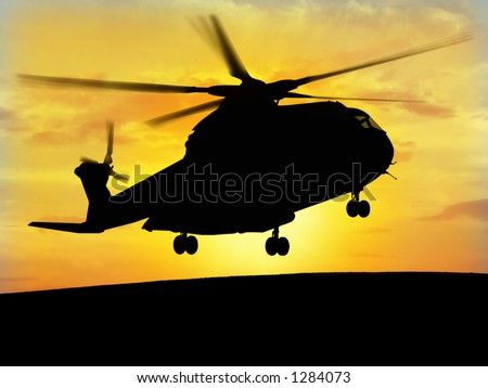 Helicopter silhouette with the sunshine in the bottom.