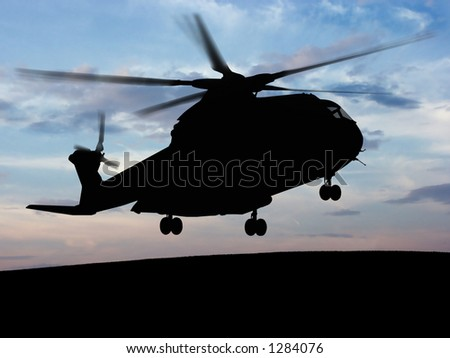 Helicopter silhouette with the sunshine in the bottom. - stock photo