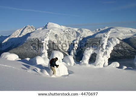 Helicopter Skier On Mountain Top