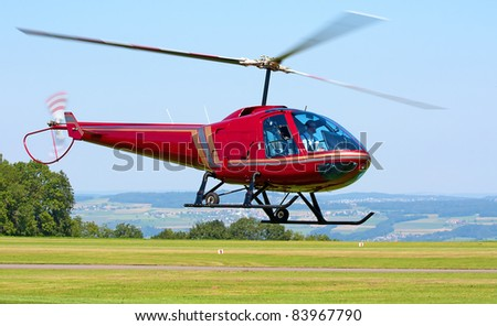 Helicopter taking off from the small airfield - stock photo