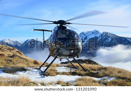 Helicopter waiting for hunters in South Westland's Southern Alps, New Zealand