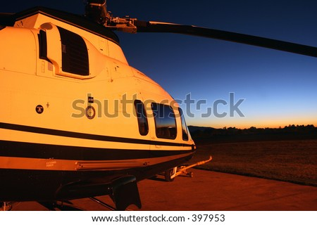 Helicopter waiting for takeoff at sunrise