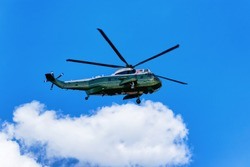 Helicopter was flying in the sky in Washington D.C., USA. Helicopter with inscription United States of America was flying near the White House.
