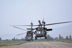 Helicopters take off the ground, during training