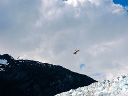 Helicopters taking off from a  glacier  in Alaska