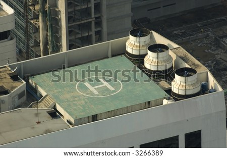Helipad on Bangkok building - stock photo