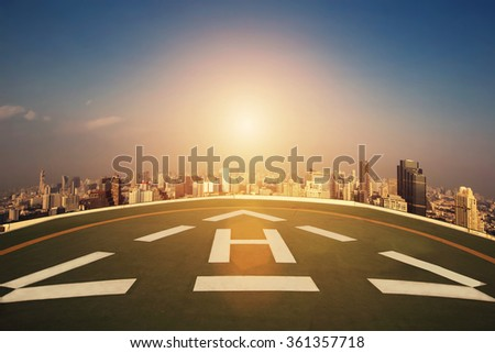 Helipad on the roof of skyscraper. Sun on sunset sky. Abstract Way, new Start concept