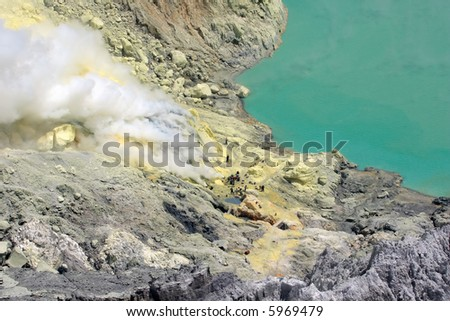 Hell. Extraction of sulfur in crater Ijen volcano.