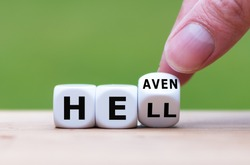 Hell or heaven? Hand turns a dice and changes the word